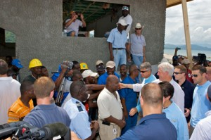 President Clinton greeting the press and local people