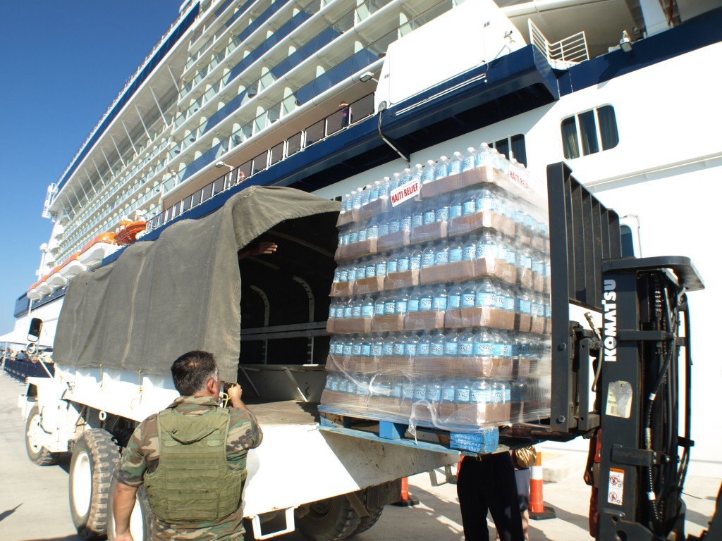 Palettes of water being loaded into a UN truck at Labadee