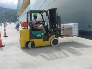 Haiti Relief Effort - Royal Caribbean employee unloads supplies in Labadee from Independence of the Seas