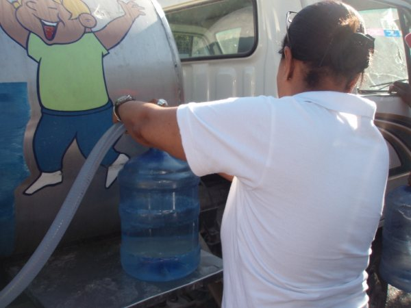 Water being distributed to the Haitian people