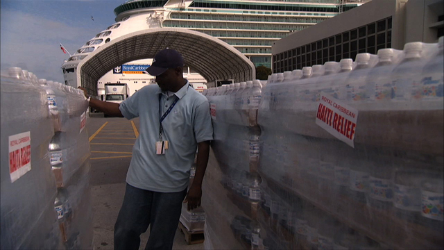 Palettes of water being loaded onto Navigator of the Seas