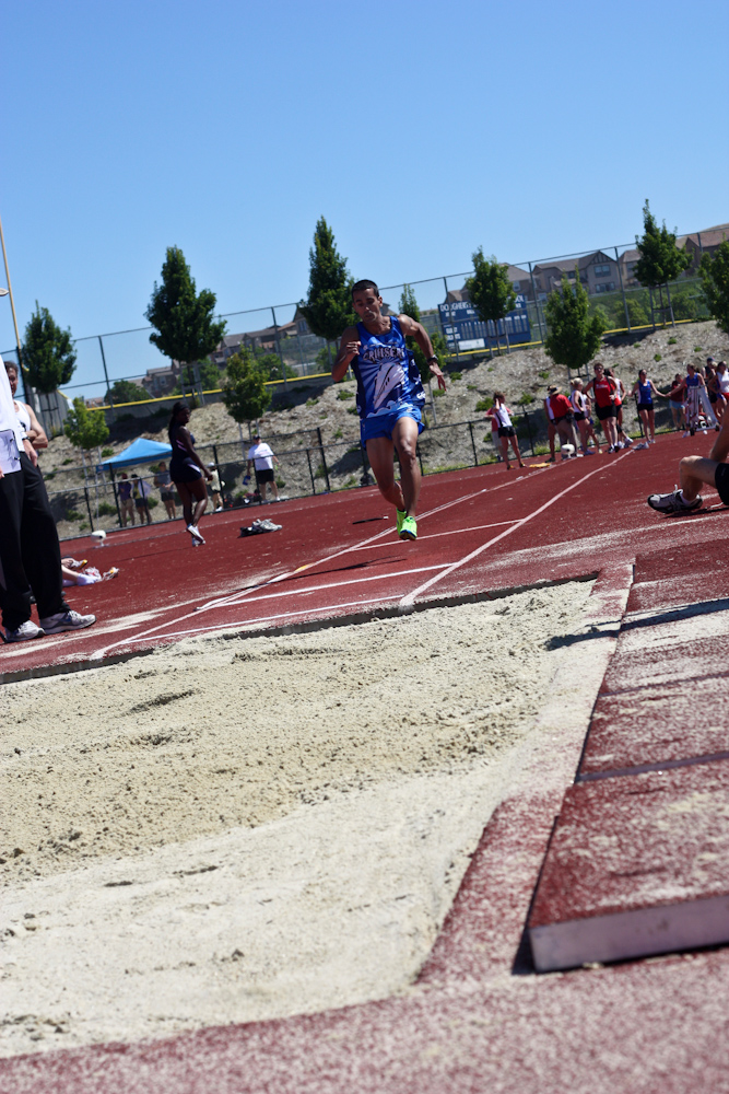 Lou Arias Competing in the Long Jump