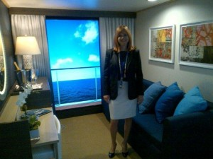 Vicki in a mockup of Royal Caribbean's Virtual Balcony Staterooms available on Quantum, Anthem & Navigator of the Seas.